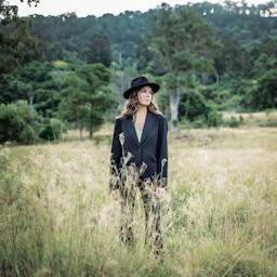 Live music artist Brianna in a long grass field